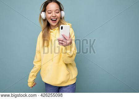 Photo Shot Of Beautiful Joyful Smiling Young Female Person Wearing Stylish Casual Outfit Isolated Ov
