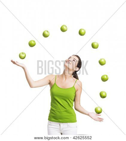 Healthy woman throwing apples, isolated over a white background