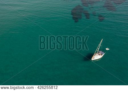 Aerial View Of A Luxury Yacht Anchored In The Surface Of The Sea. Cyprus Holidays