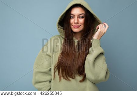 Young Beautiful Woman Looking At Camera. Trendy Girl In Casual Hipster Hoodie Clothes. Positive Fema