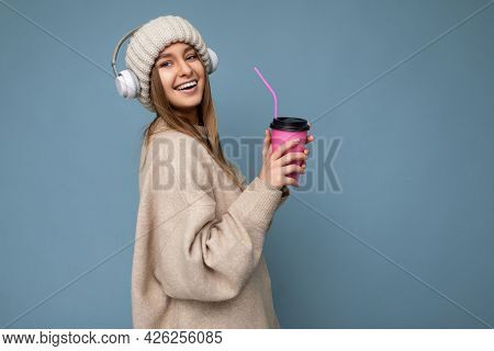 Beautiful Happy Smiling Young Blonde Female Person Wearing Beige Winter Sweater And Hat Isolated Ove