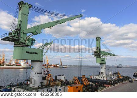 Odessa, Ukraine, October 9, 2012: Green Floating Crane Of Liebherr Company In The Seaport Of Odessa
