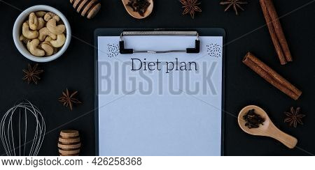 Diet Plan Baking Cooking Ingredients On Black Background. Top View. Blank Clipboard Copy Space. Home