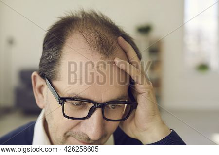 Closeup Worried Mature Businessman Holding Head With Hand Looking Disappointed