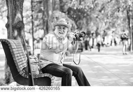 Explore City. Tourism Hobby. Tourist Concept. Travel And Tourism. Photographer Sit On Bench In Park.