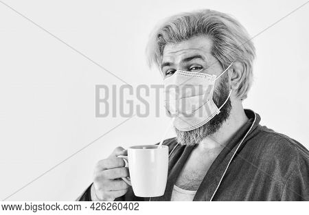 Guy In Mask Drink Tea Coffee Using Straw. Serious About Hygiene. Cover Mouth And Nose With Mask And