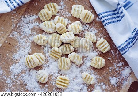 Home Made Gnocchi With Flour On Wooden Pastry Board. Hand Made Gnocchi Di Patata, Traditional Italia