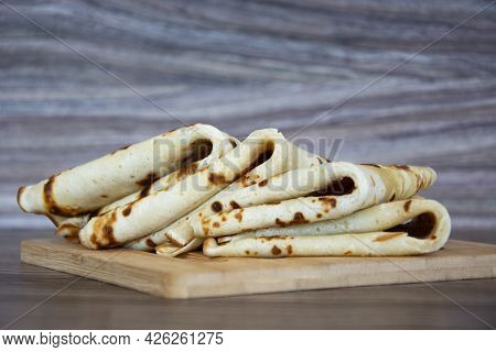 Pancakes. Pancakes Stacked In A Stack On A Wooden Background. Diet Baked Goods For Breakfast.