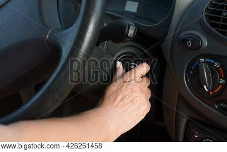 Close-up Of Mature Woman's Hands Turning A Car With A Key. An Elderly Woman Driver Starts The Car, I