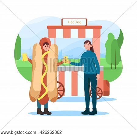 Female Character Is Giving Away Flyers In Hot Dog Costume Near Hot Dog Kiosk. Concept Of Advertiseme