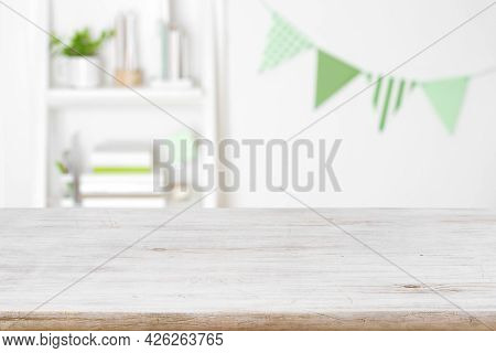 Blurred Room Of Schoolchild With Wooden Table Surface In Front
