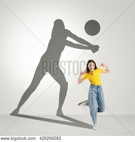 Conceptual Image With Preschool Girl And Shadow Of Female Volleyball Player On Light Gray Background