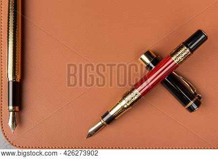 Fountain Pens Exposed On A Leather Surface, Selective Focus.