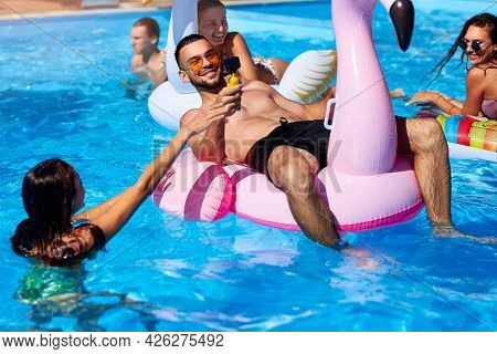 Travel Blogger Man Taking Selfie Photo With Action Camera In A Swimming Pool. Lifestyle Vlogger Film