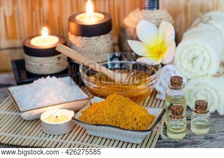 Organic Curcumin Or Turmeric In Ceramic Bowl With Blur Honey, Spa Salt, Aroma Gel, Candle, And Soft