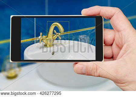 Water Tap On Smartphone Screen. Water Tap And Sink In The Bathroom. The Interior Of The Living Quart