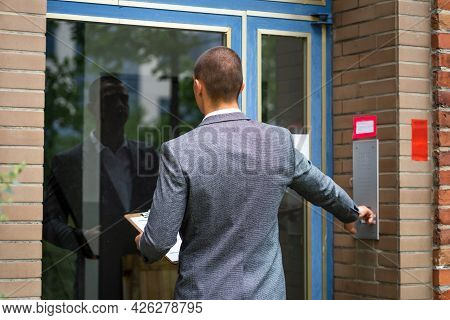 Bailiff Debt Collector Touching Doorbell. Confiscation And Seizure