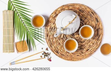 Tea Ceremony With Teapot And Tea Cups Top View On White Background.  Asian Tea Ceremony.