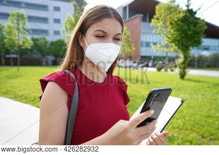 Busy Female Manager With Ffp2 Kn95 Protective Mask Checking Her Smartphone When Walking Outside Her