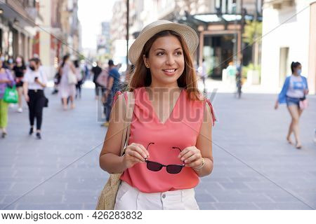 Fashionable Pretty Young Woman Strolling In Pedestrian Street