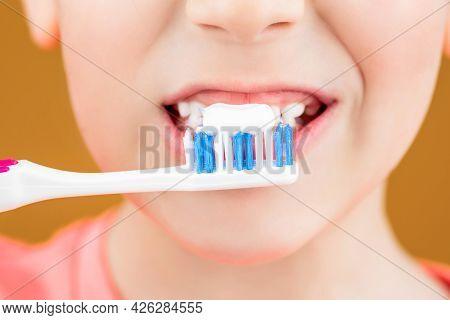 Health Care, Dental Hygiene. Joyful Child Shows Toothbrushes. Little Boy Cleaning Teeth. Dental Hygi