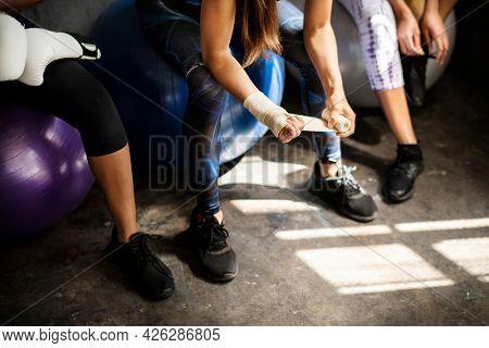 Sportive women talking in a gym