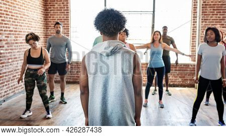 Trainer with his group fitness class