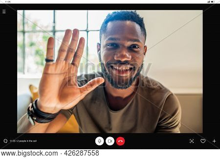 Young Man Saying Hello To Someone While