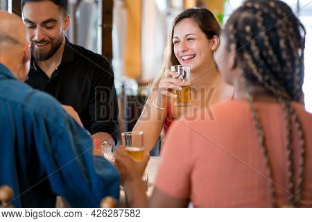 Group Of Friends Enjoying Drinking Beer Together
