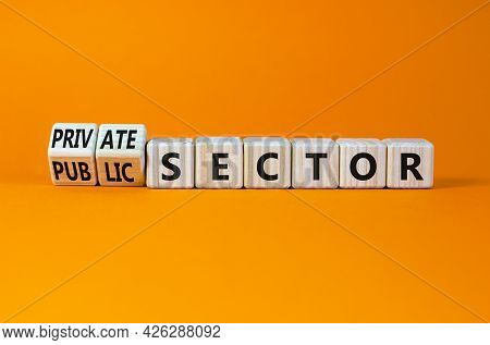 Private Or Public Sector Symbol. Turned Wooden Cubes, Changed Words 'public Sector' To 'private Sect