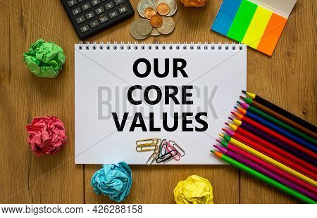 Our Core Values Symbol. White Note With Words 'our Core Values' On Beautiful Wooden Table, Colored P