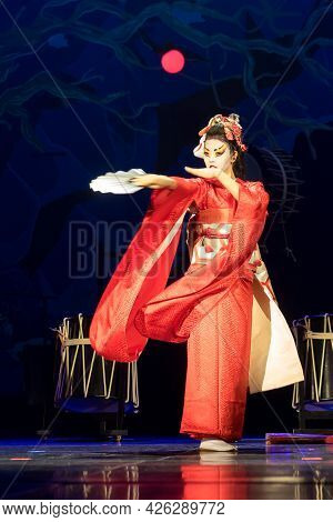 Woman Dances With A Fan. Traditional Japanese Performance Red Fox Dance. Kino Kitsune Fox Is A Chara