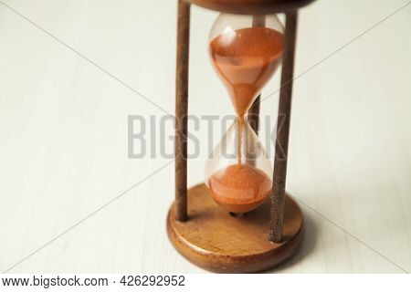 Hourglass With Concept Of Passing Time, Race Against Time, Urgency And Priority. Hours, Days, Weeks,