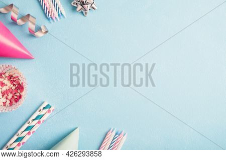 Birthday Party Background. Carnival Caps, Pink Sweet Confetti, Drinking Straws, Streamers And Candle