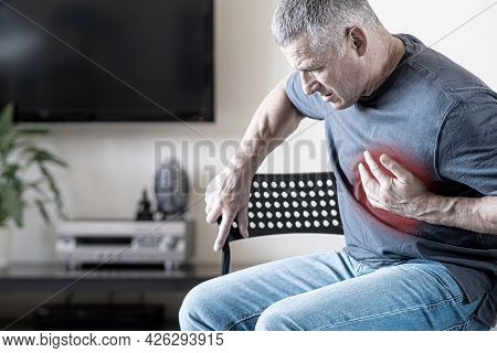 A Person Experiences Chest Pain Caused By A Heart Attack. Heart Disease. Angina Pectoris. The Concep