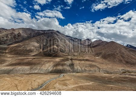 High altitude mountain road in Himalayas near Kardung La pass in Ladakh, India