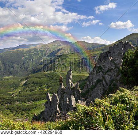 Golden Eagle ( Aquila Chrysaetos ) On Rocky Mountains. Beautiful Mountain Landscape, Rainbow In The