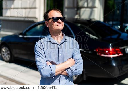 Caucasian Man Forty Years Old Businessman In The City In The Summer On The Background Of The Car.