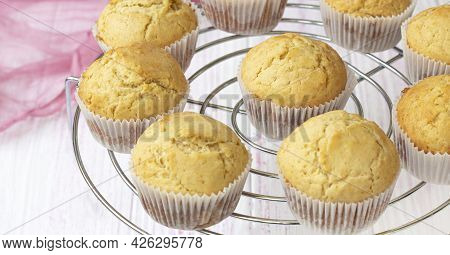 Selective Focus. Classic Homemade Muffins Are Cooled On A Wire Rack To Cool.
