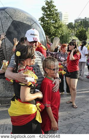 Donetsk, Ukraine - June 27, 2012: Fan Of Spain Together With The Fans Of Portugal In Donetsk Before