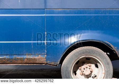 Severe Corrosion On The Old Blue Car. An Old Rusty Car