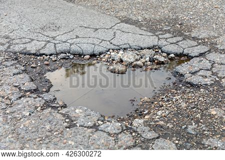 Big Pot Hole Filled With Rain Water Damaged Street Problem