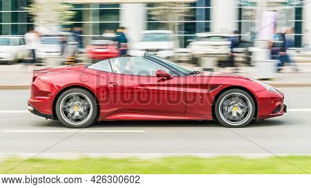 Moscow, Russia - May 2021: Ferrari California T Rides On Street On High Speed. Red Sportscar With Tw