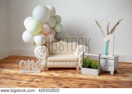 Beautiful Location For A Children's Photo Shoot For One Year. Sofa, Balls, Number One On The Wooden