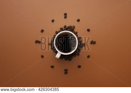 Coffee Cup And Roasted Beans Arranged As Clock Face On Brown Background. Coffee Time Concept. Coffee