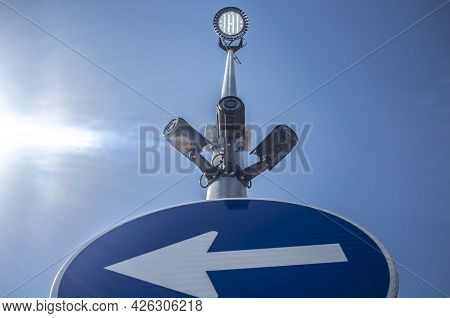 Three Surveillance Camera Attached On Traffic Signal Pole With Led Spotlight On The Top. Blue Sky Wi