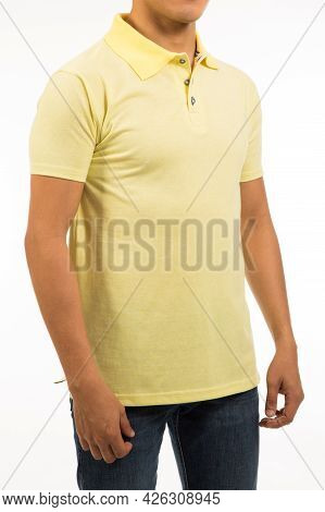 Latino Guy In Yellow Shirt With Short Sleeve In His 30s Stand Relax Pose And Arm Aside With Hand