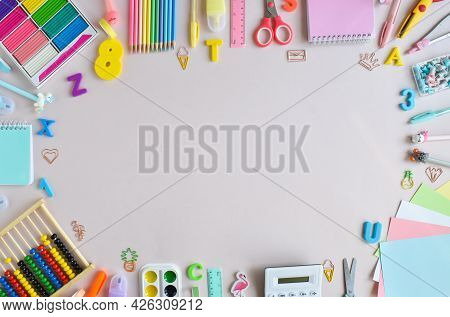Background Of School Supplies In Pastel Colors On A Light Beige Background, A Place For Text. Office