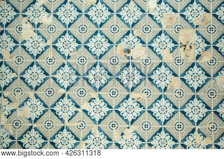 Azulejos ceramic tilework, traditional old tiles wall on the street. Porto, Portugal.