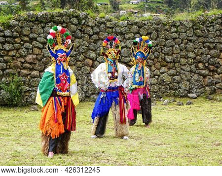 Chobshi, Azuay, Ecuador - June 20,2021: Group Of Dancers As Folk Characters Devil Huma Performs Outd